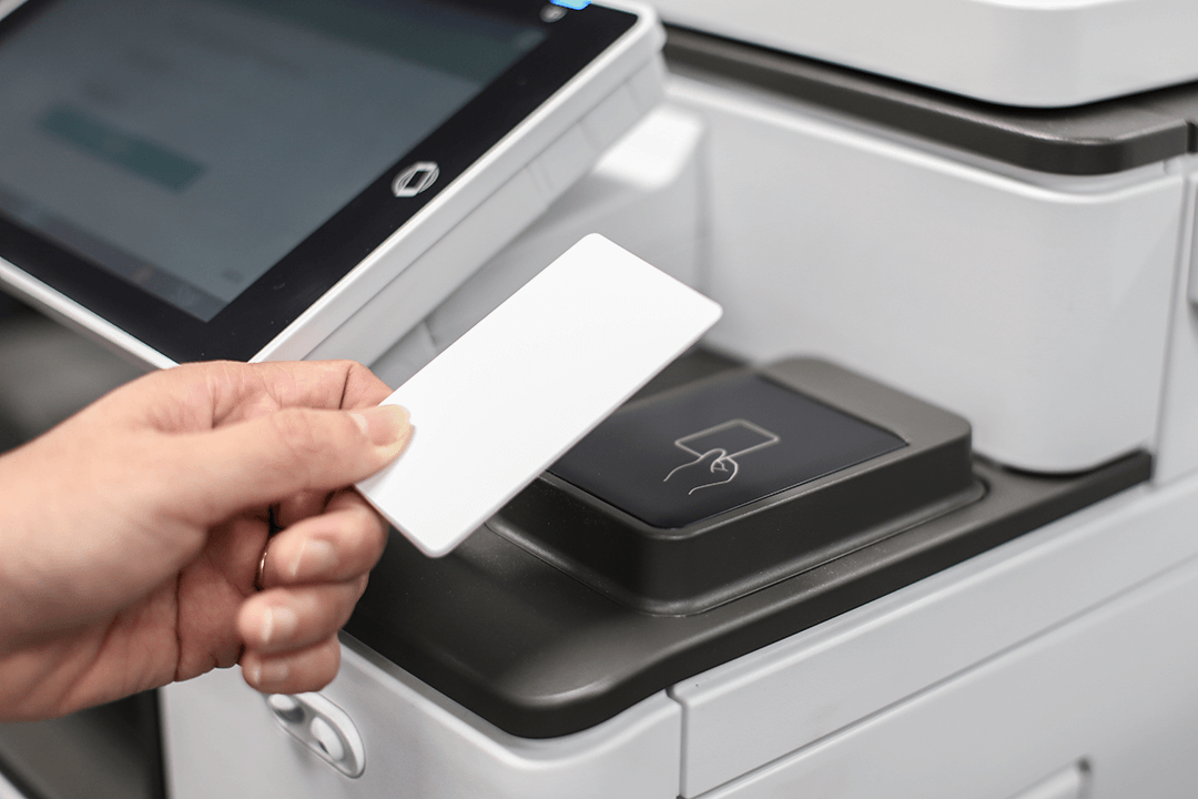 A swipe card being used to access a printer running PaperCut MF