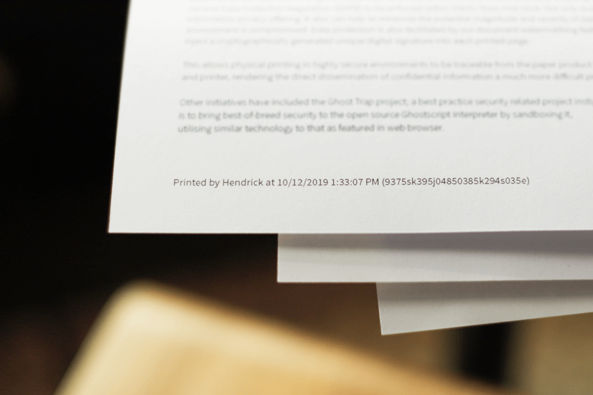 Photo (including some tasteful blurring) showing a digital signature watermark applied to the bottom of a printed document.